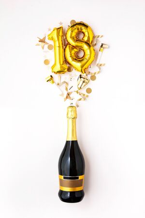 Happy 18th anniversary party. Champagne bottle with gold number balloon.