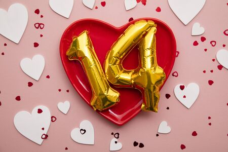 Happy valentines day background. Red heart with foil number 14 balloons 版權商用圖片