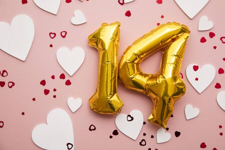 February 14th. Valentines day gold foil balloon background