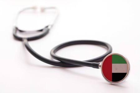 UAE healthcare concept. Medical stethoscope with country flag