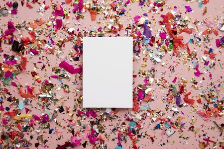 Blank card on colourful party sparkling party confetti