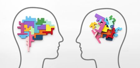 Right and left sides of the brain concept. Puzzle pieces in the shape of a brain