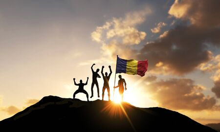 A group of people celebrate on a mountain top with Romania flag. 3D Render