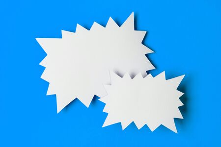 Blank promotional starburst sales banner on a bright blue background