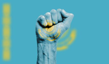 Kazakhstan flag painted on a clenched fist. Strength, Protest concept