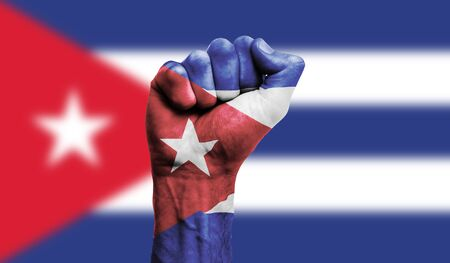 Cuba flag painted on a clenched fist. Strength, Protest concept