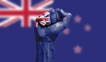 New Zealand flag painted on a clenched fist. Strength, Protest concept
