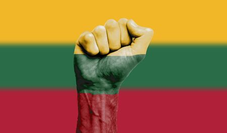 Lithuania flag painted on a clenched fist. Strength, Protest concept 版權商用圖片