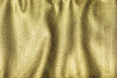 Gold painted background with ripples