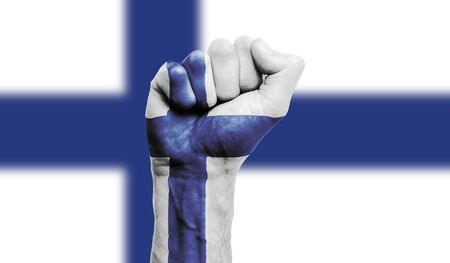 Finland flag painted on a clenched fist. Strength, Protest concept