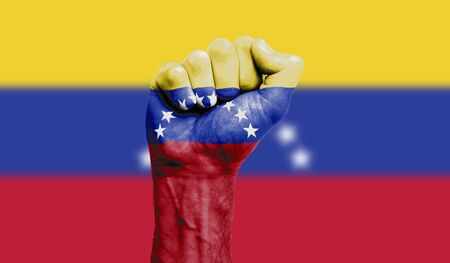 Venezuela flag painted on a clenched fist. Strength, Protest concept