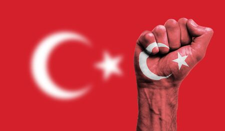 Turkey flag painted on a clenched fist. Strength, Protest concept