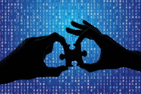 Silhouette of a hands holding a jigsaw puzzle piece with binary background