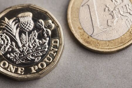 British one pound coin and one euro coin. Exchange rate concept