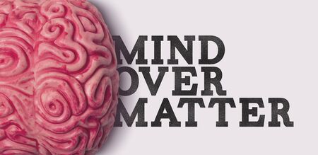 Mind Over matter word next to a human brain model