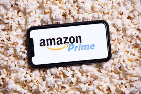 LONDON, UK - MAY 14 2020: Amazon Prime logo on a smartphone with popcorn