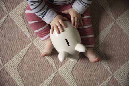 financial planning. baby with a piggy bank investing for their future Фото со стока