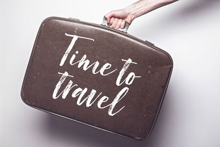 Time to travel to travel message on a vintage travel suitcase Фото со стока