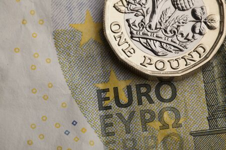 British one pound coin and european note. Exchange rate concept