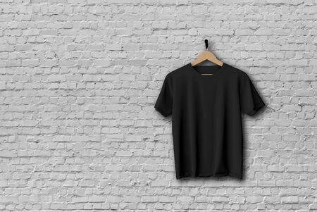 Black t-shirt mock up hanging against a brick wall 3D Rendering