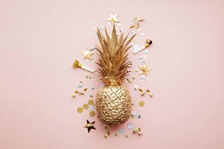 Flat lay tropical pineapple and confetti party celebration background.
