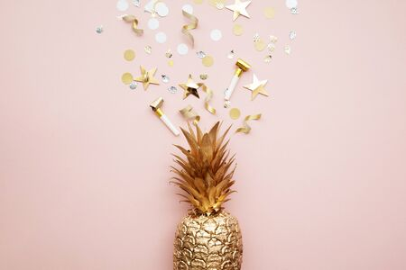 Flat lay tropical pineapple and confetti party celebration background