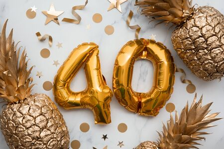 40th birthday celebration card with gold foil balloons and golden pineapples