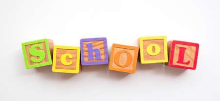 School word made from colourful wooden baby development blocks