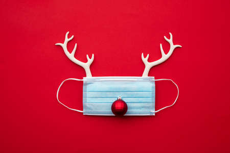 Festive christmas reindeer made from face mask and decorations