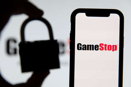 LONDON, UK - February 2021: Gamestop video game with a security padlock Publikacyjne