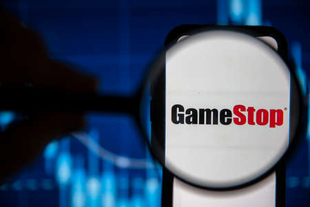 LONDON, UK - February 2021: Gamestop video game under magnifying glass