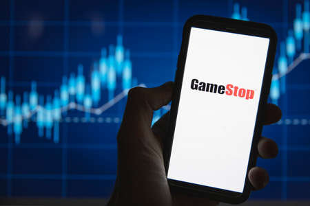 LONDON, UK - February 2021: Gamestop in front of stock market price graph Publikacyjne