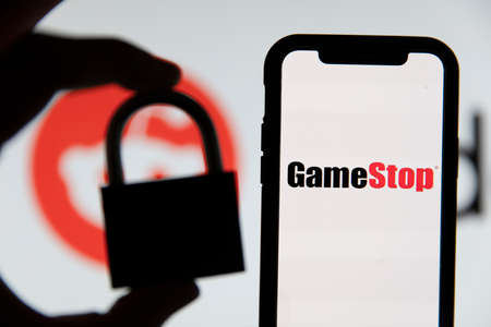 LONDON, UK - February 2021: Gamestop and reddit with a security padlock