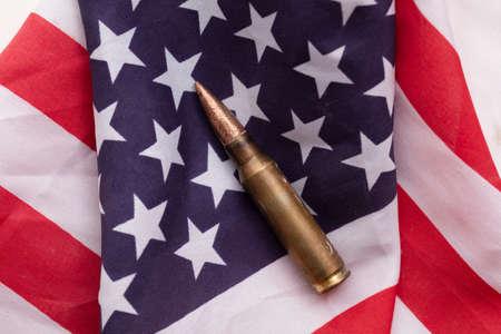 Bullet ammunition on a United states stars and stripes flag Foto de archivo