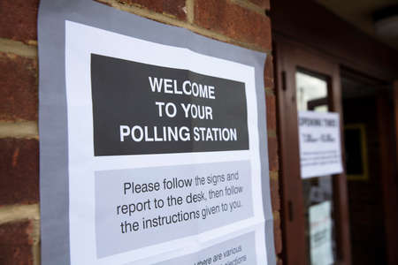 Polling station sign outside the entrance to a political voting location in UK