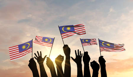 Silhouette of arms raised waving a Malaysia flag with pride. 3D Rendering