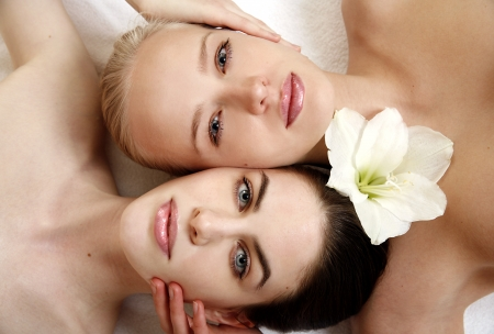 Beauty shot of two young faces side by side Stock Photo