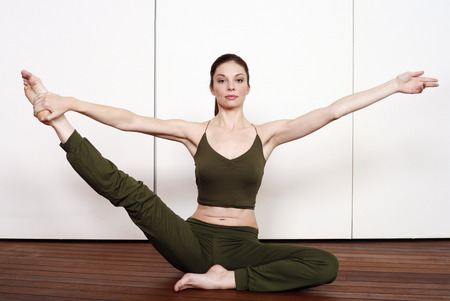 athletic wear: Young woman performing a pilates stretch