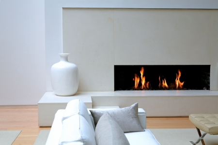 White living room with burning fireplace *** Local Caption *** -