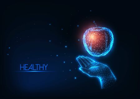 Futuristic healthy diet, nutrition concept with glowing low polygonal human hand holding colorful apple