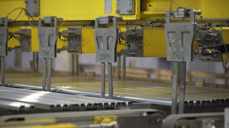 Aluminium extrusion production line factory warehouse. Plastic windows manufacture.