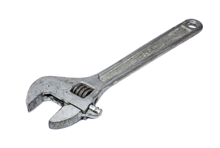 bolts and nuts: Adjustable wrench isolated on white background
