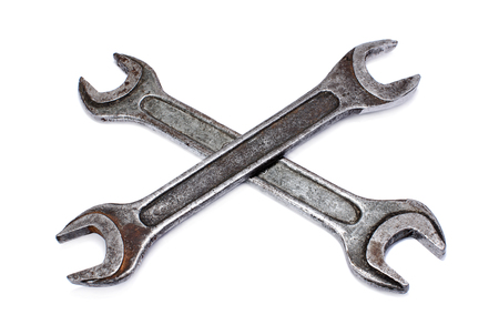 Crossed wrenches on white background