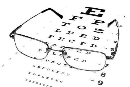 Glasses In A Silver Rimmed On The Snellen Eye Chart Stock Photo