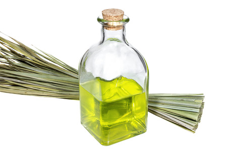 Bottle with aroma oil and bunch of medicinal herbs Stock Photo
