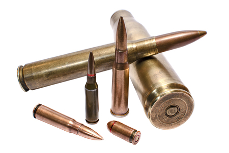 Military conceptioin: cartridges for large-caliber machine-gun, assault rifle and handgun closeup Stock Photo