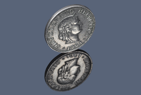 Swiss coin of ten centimes isolated on dark background