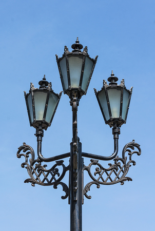 Retro streetlight on blue sky background Stock Photo