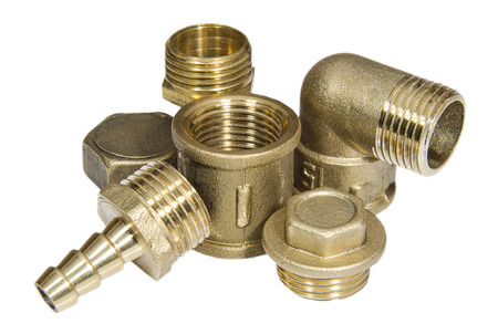 Brass fittings for plumbing pipeline on the white surface Foto de archivo