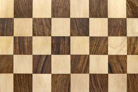 Dark wooden chessboard checkered background Stock Photo